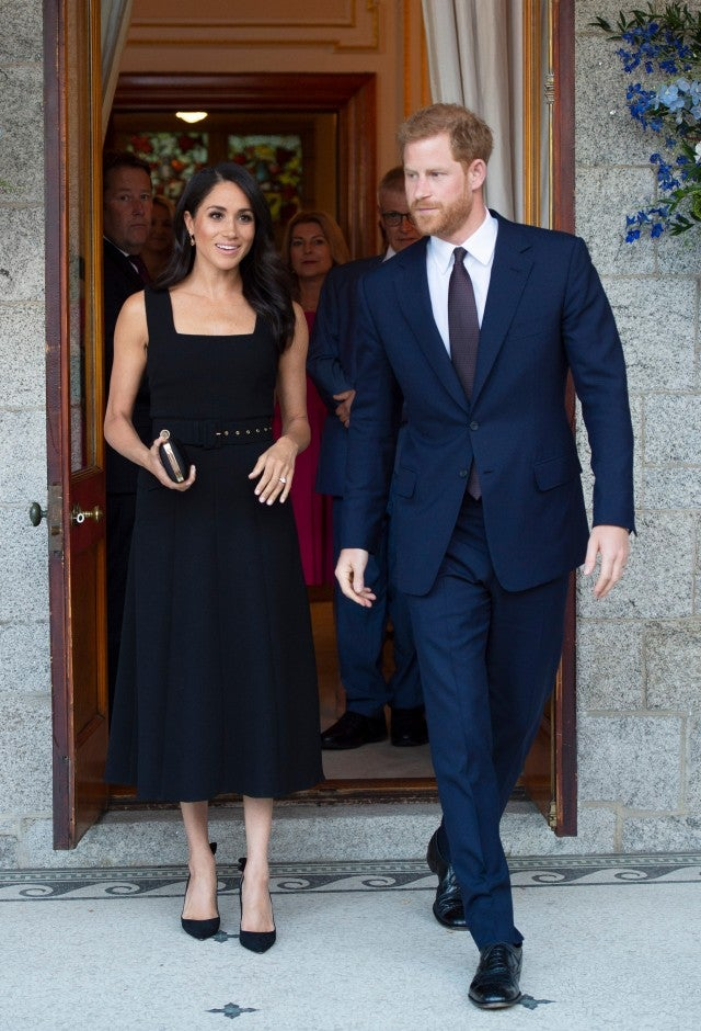 Meghan Markle in Emilia Wickstead dress with Prince Harry