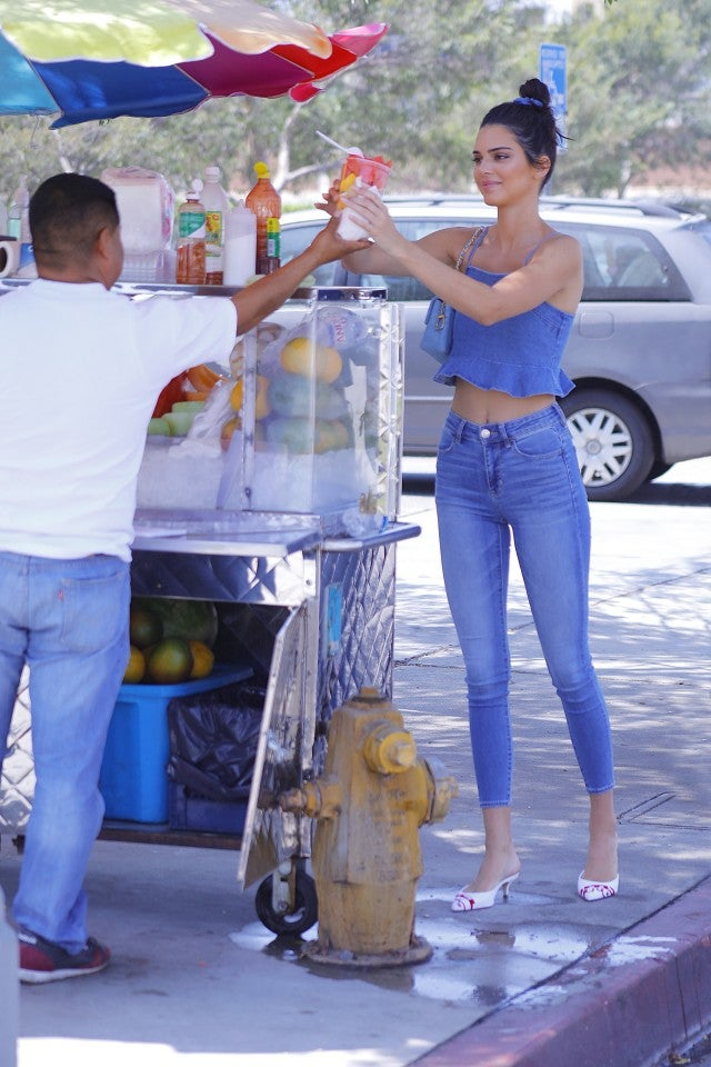 Kendall Jenner at fruit stand in denim