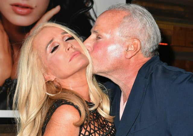 Wynn Katz kisses Kim Richards at the premiere part for WE tv's 'Marriage Boot Camp: Reality Stars.'