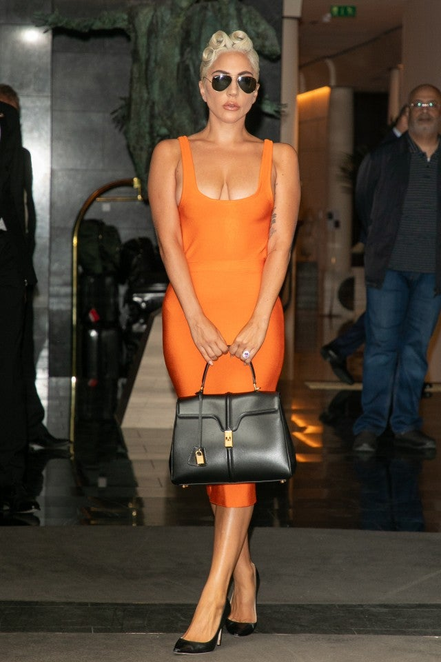 Lady Gaga orange dress with Celine bag