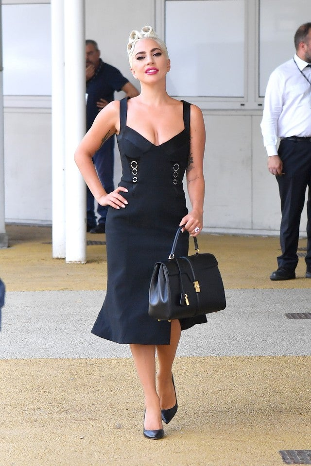Lady Gaga black dress and Celine bag at Venice Film Festival
