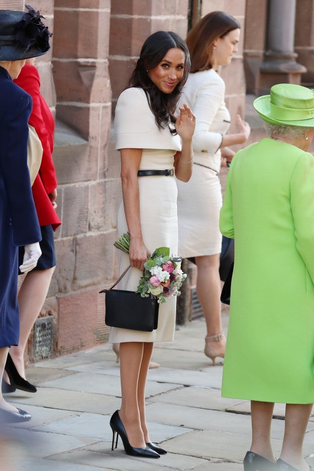 Meghan Markle black clutch and shoes