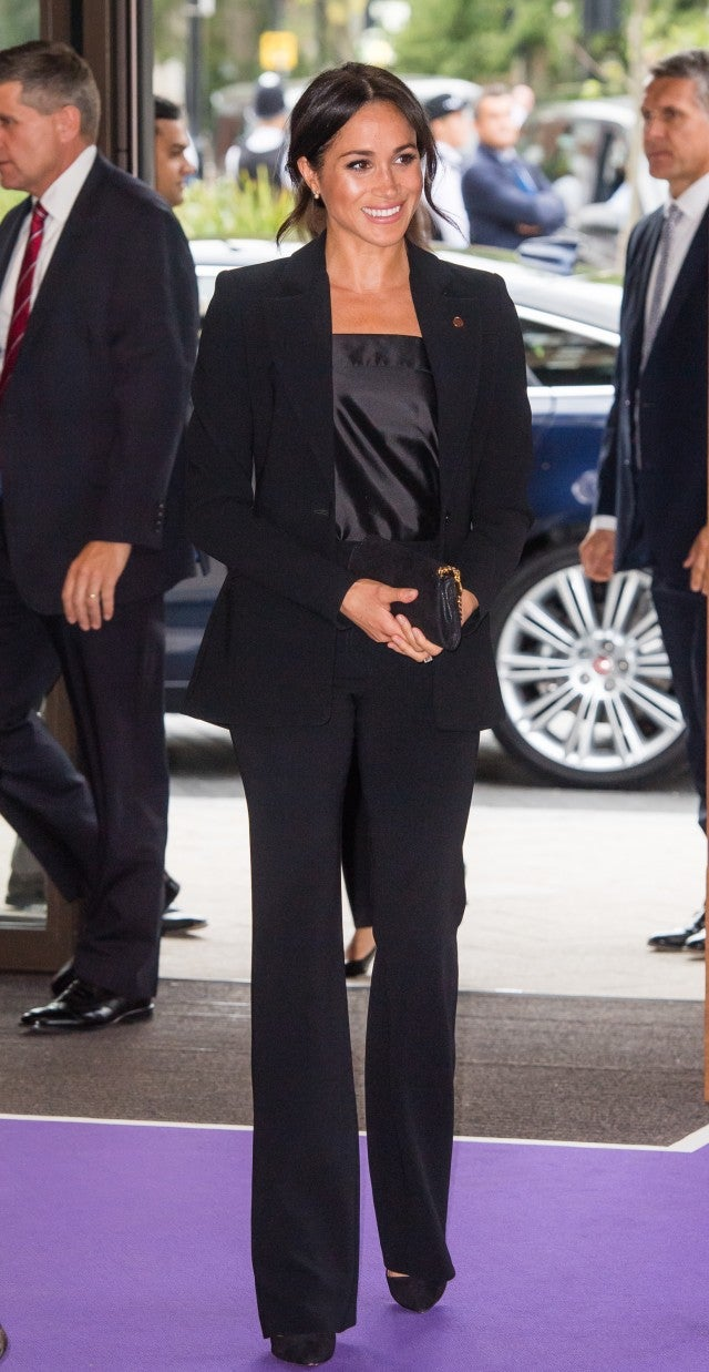 c498241e07d Meghan Markle Looks Like a Total Boss Babe in Sleek Black Pantsuit ...