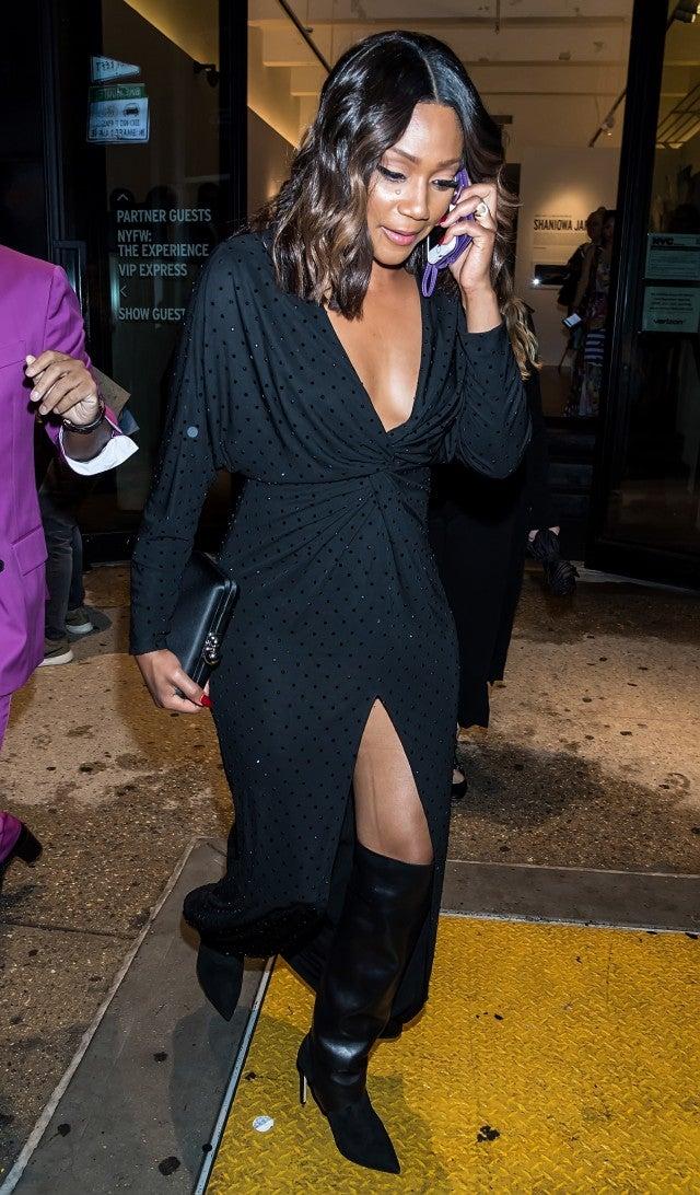 Tiffany Haddish in black dress and boots