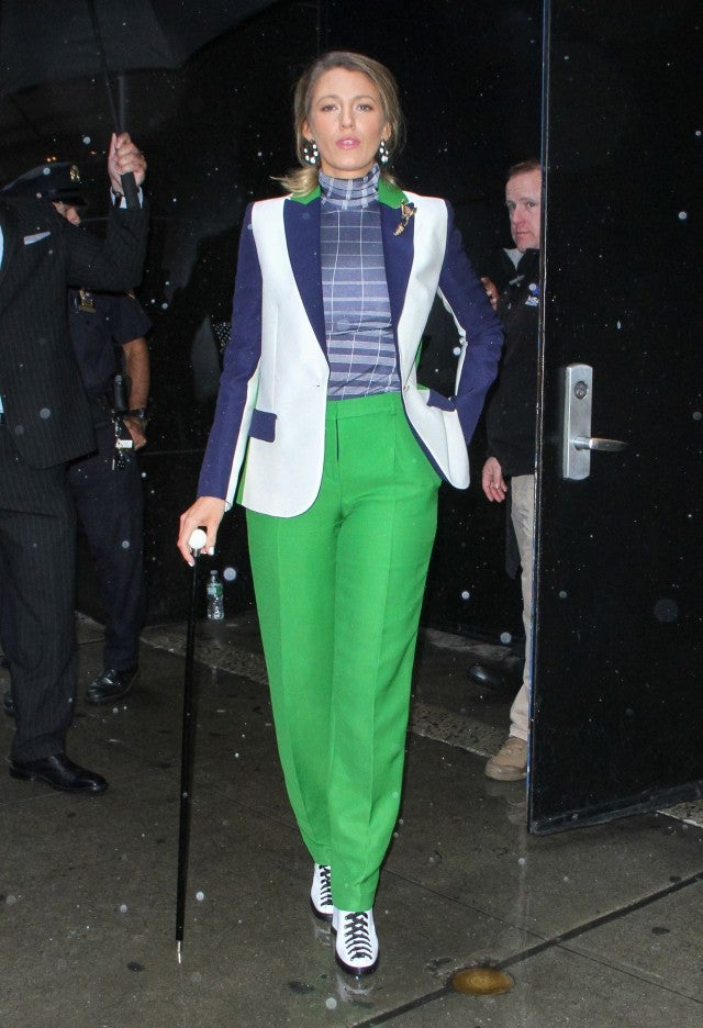 Blake Lively in green suit pants and cane