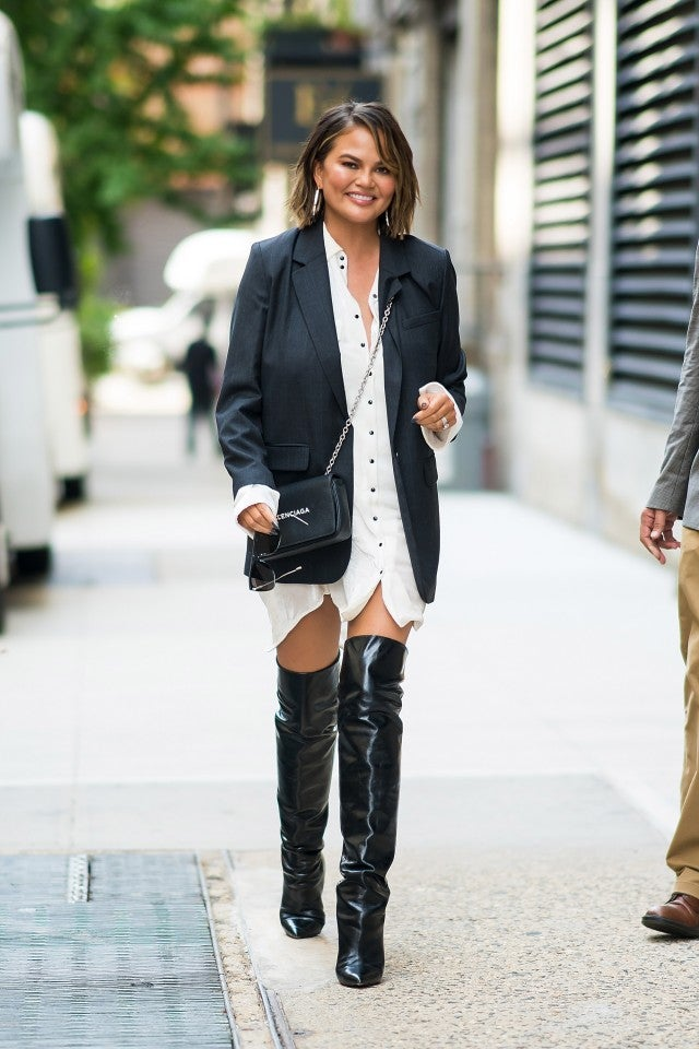 Chrissy Teigen in blazer, shirt dress and OTK boots