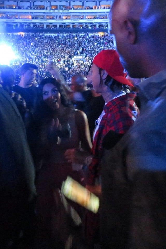 Kim Kardashian runs into Tyga at Beyonce and JAY-Z's On the Run II concert on Sept. 23, 2018.