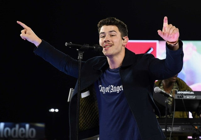 Nick Jonas performs at a chairty concert on the field at Angel Stadium
