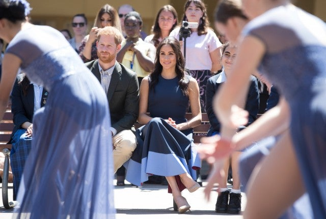 Prince Harry and Meghan Markle watching dance performance