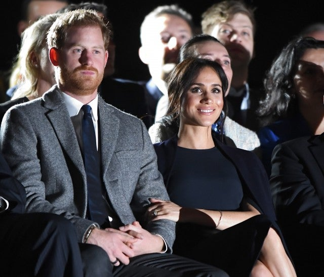 Prince Harry takes to 'budgie smugglers' as Meghan takes a break