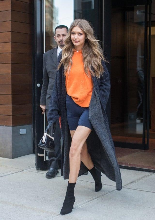 Gigi Hadid in orange hoodie for VS rehearsals