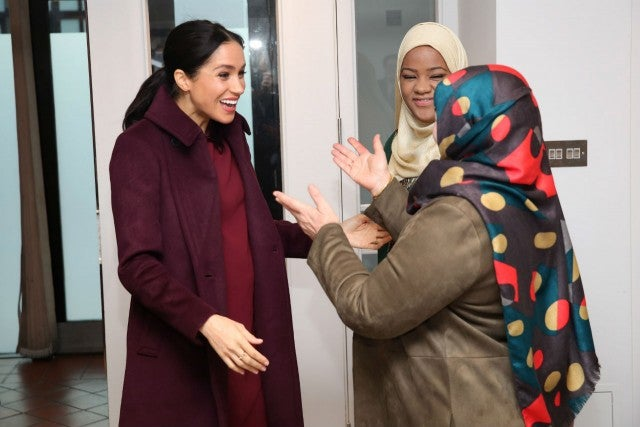 Meghan reunites with Grenfell charity cookbook women