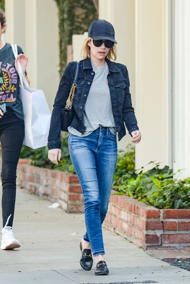 Emma Roberts in cap and jeans