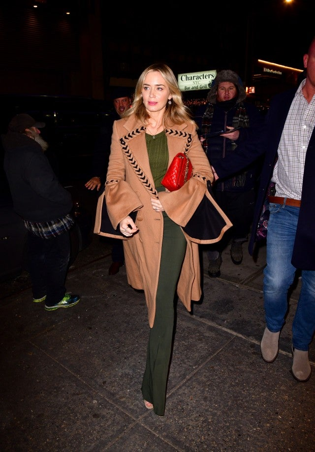 Emily Blunt in camel coat and olive green outfit