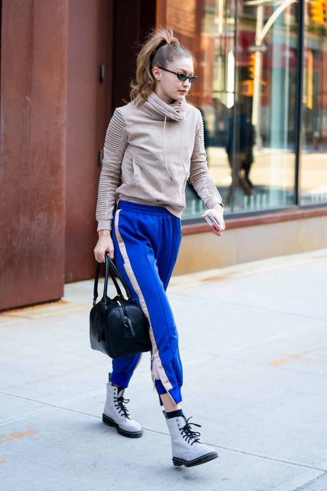 Gigi Hadid in blue sweatpants and lace-up boots