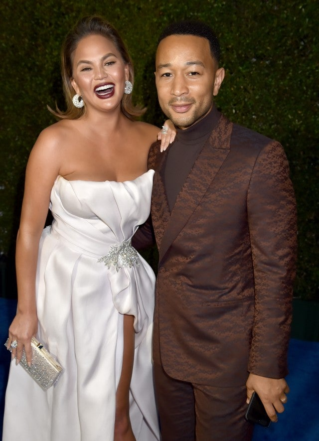 Chrissy Teigen and John Legend at The 24th Annual Critics' Choice Awards at Barker Hangar on January 13, 2019 in Santa Monica, California
