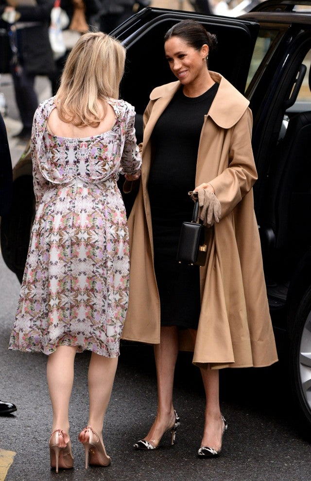 Meghan Markle Helps Dress Women For Success While Showing