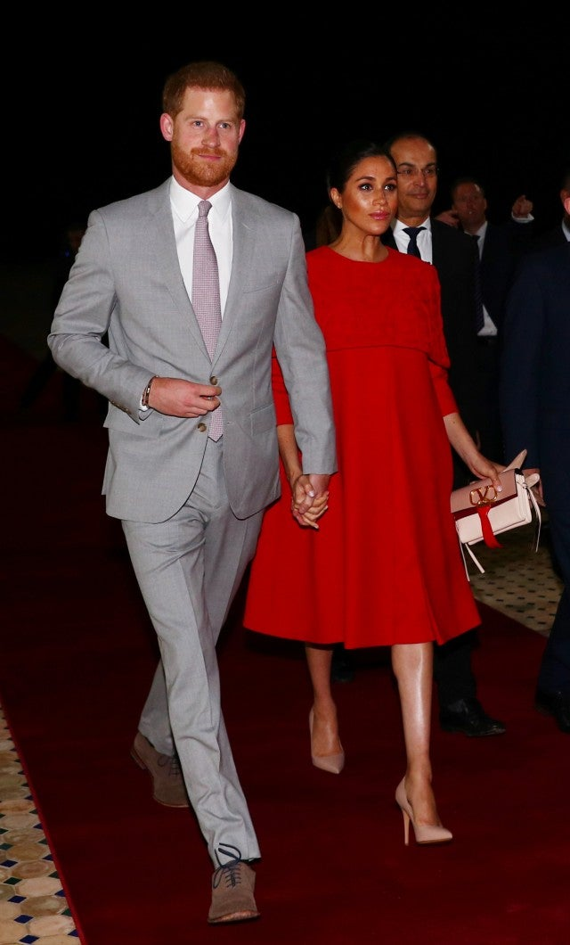 Meghan Markle in red dress with Prince Harry in Morocco
