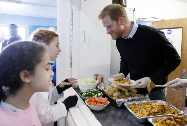 Prince Harry serves healthy food to children in London
