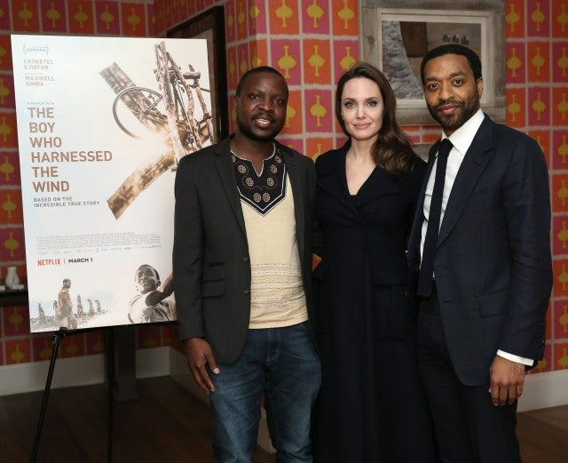 Book author William Kamkwamba, host Angelina Jolie and director Chiwetel Ejiofor attend 'The Boy Who Harnessed The Wind' Special Screening at Crosby Street Hotel on February 25, 2019 in New York City