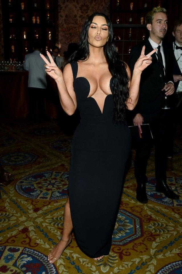 Kim And Kourtney Kardashian Rock Their Most Revealing Red