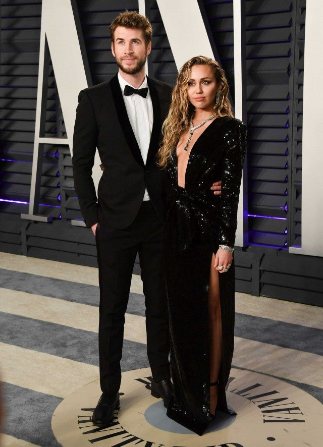 Liam Hemsworth and Miley Cyrus at the Vanity Fair Oscars Party