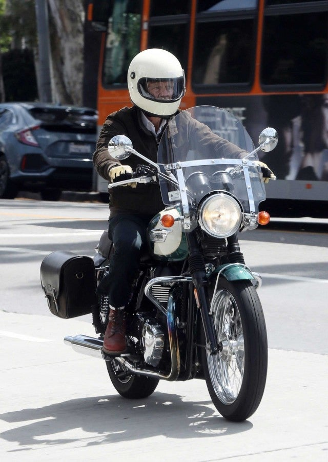 William H. Macy rides his motorcycle in Los Angeles on April 8.