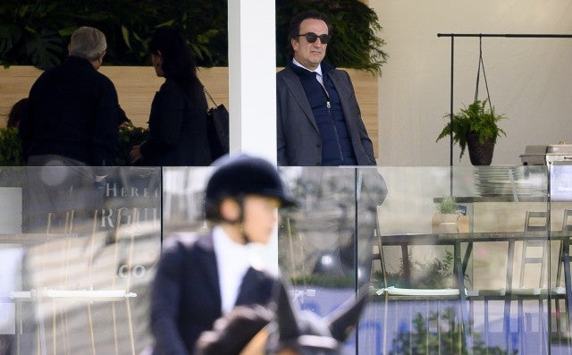 Olivier Sarkozy watches Mary-Kate Olsen competing during Madrid-Longines Champions, the International Global Champions Tour at Club de Campo Villa de Madrid on May 17, 2019