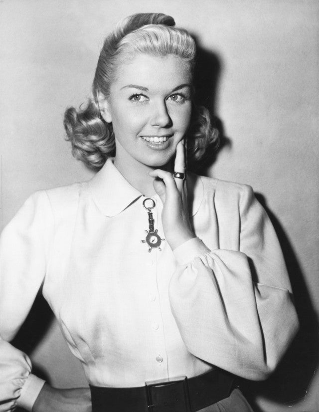 "Doris Day poses for the still cameraman between scenes of 1949 Warner Bros.' Technicolor production, ""It's a Great Feeling,"" co-starring Dennis Morgan and Jack Carson."