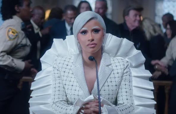 Cardi B press music video viktor & rolf suit in courthouse