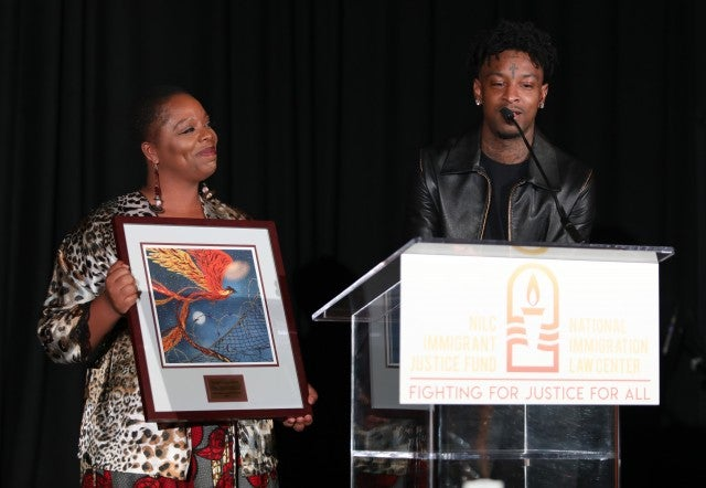 21 SAVAGE receiving the National Immigration Law Center