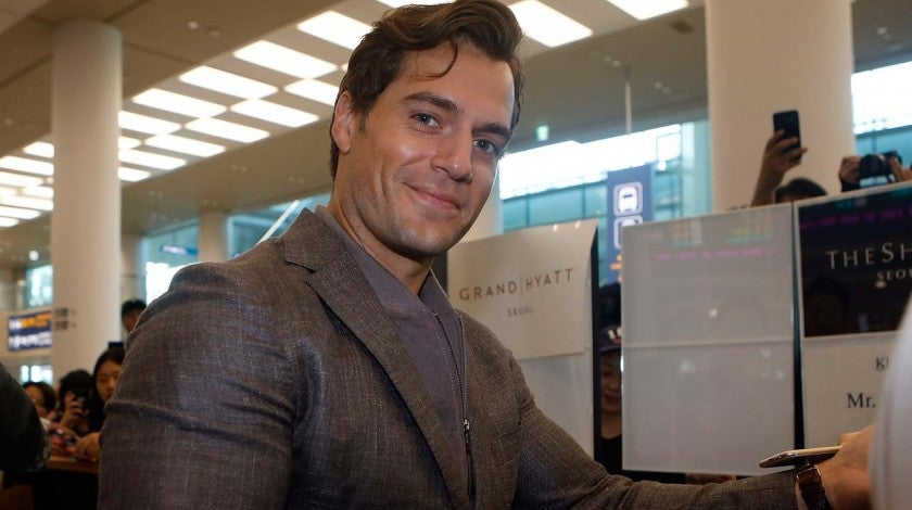Henry Cavill signs autographs for fans at the Incheon Airport in South Korea on July 15.