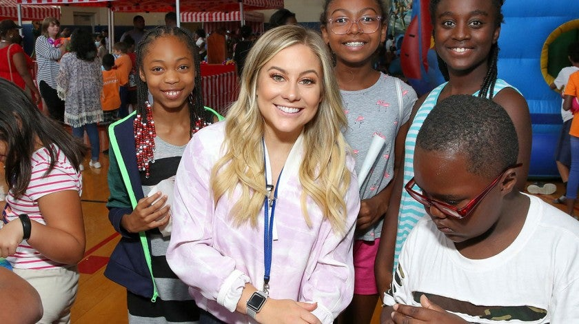 Shawn Johnson at backpack charity event