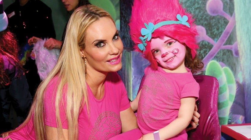 Coco Austin and daughter at trolls event