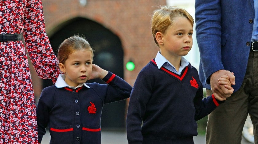 Princess Charlotte of Cambridge, with her brother, Britain's Prince George of Cambridge, arrives for her first day of school at Thomas's Battersea in London