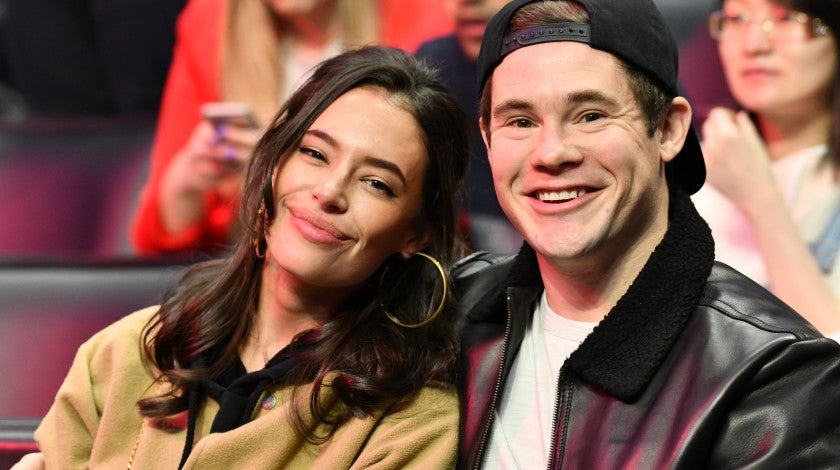 Chloe Bridges and Adam Devine at clippers game