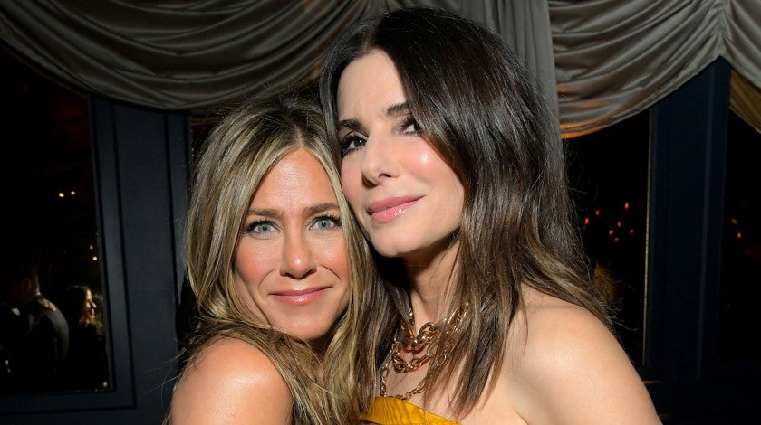 Jennifer Aniston and Sandra Bullock at gg party