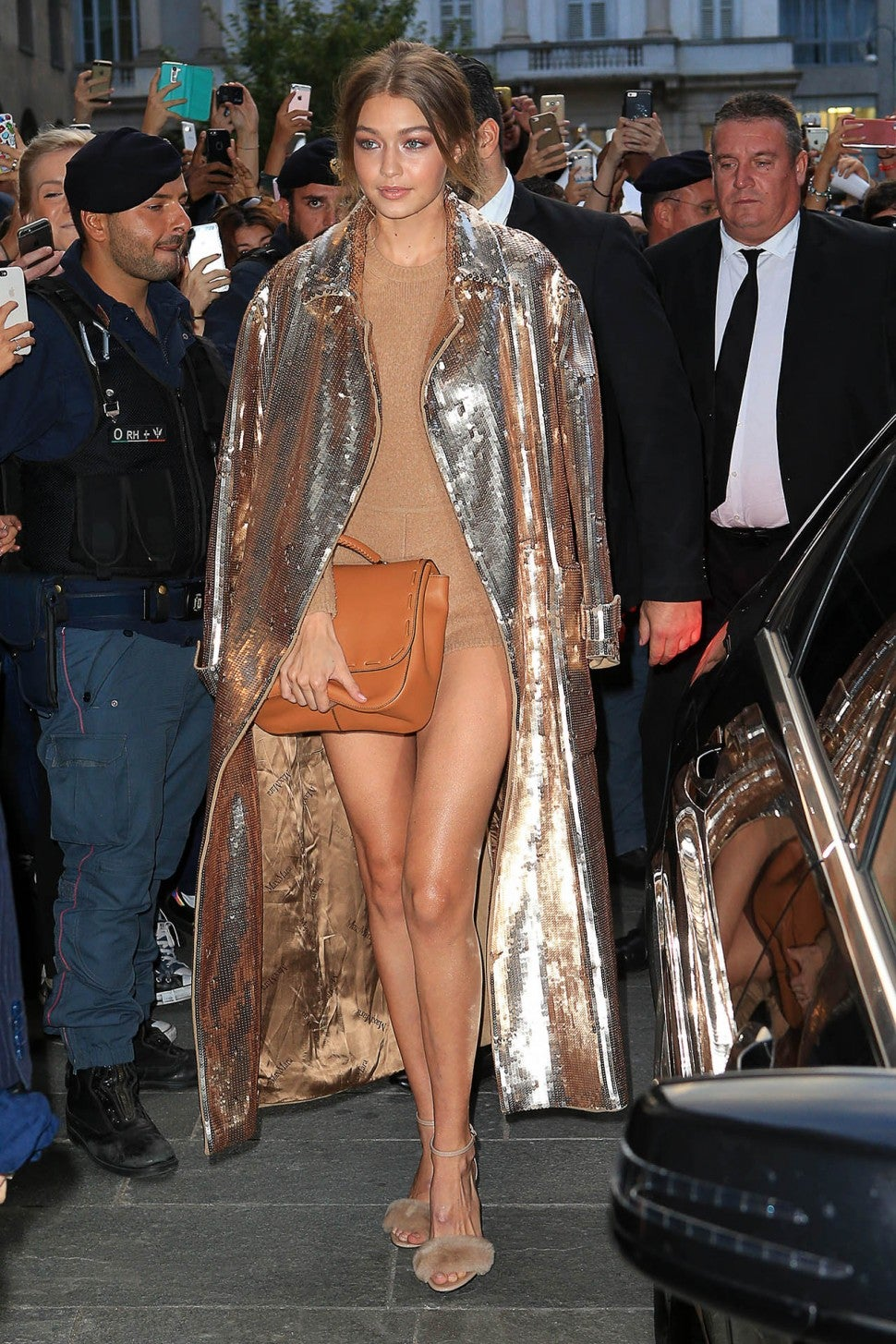 Gigi Hadid Ditches Pants, Steps Out in Nude Bodysuit