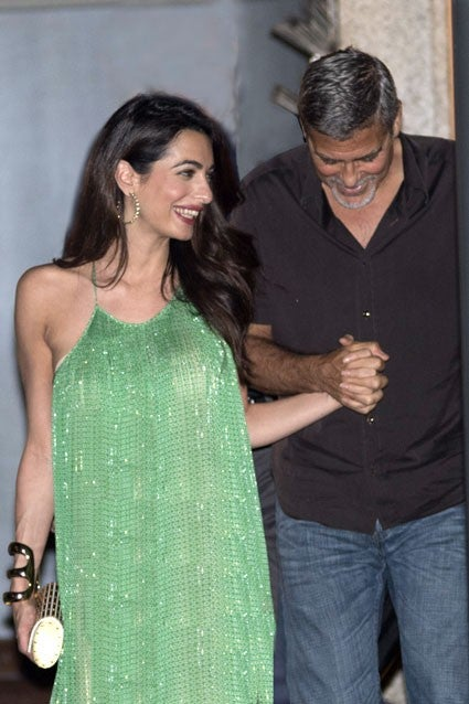 Amal and George Clooney step out on Aug. 20, 2017 in Lake Como, Italy.
