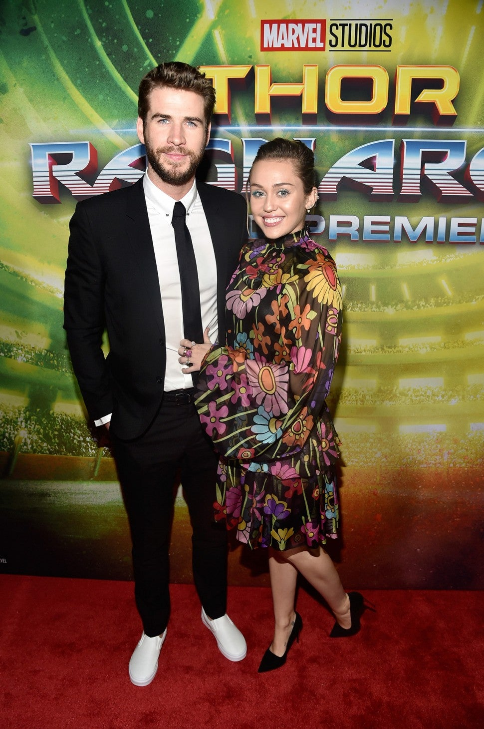 Liam Hemsworth and Miley Cyrus at 'Thor' premiere