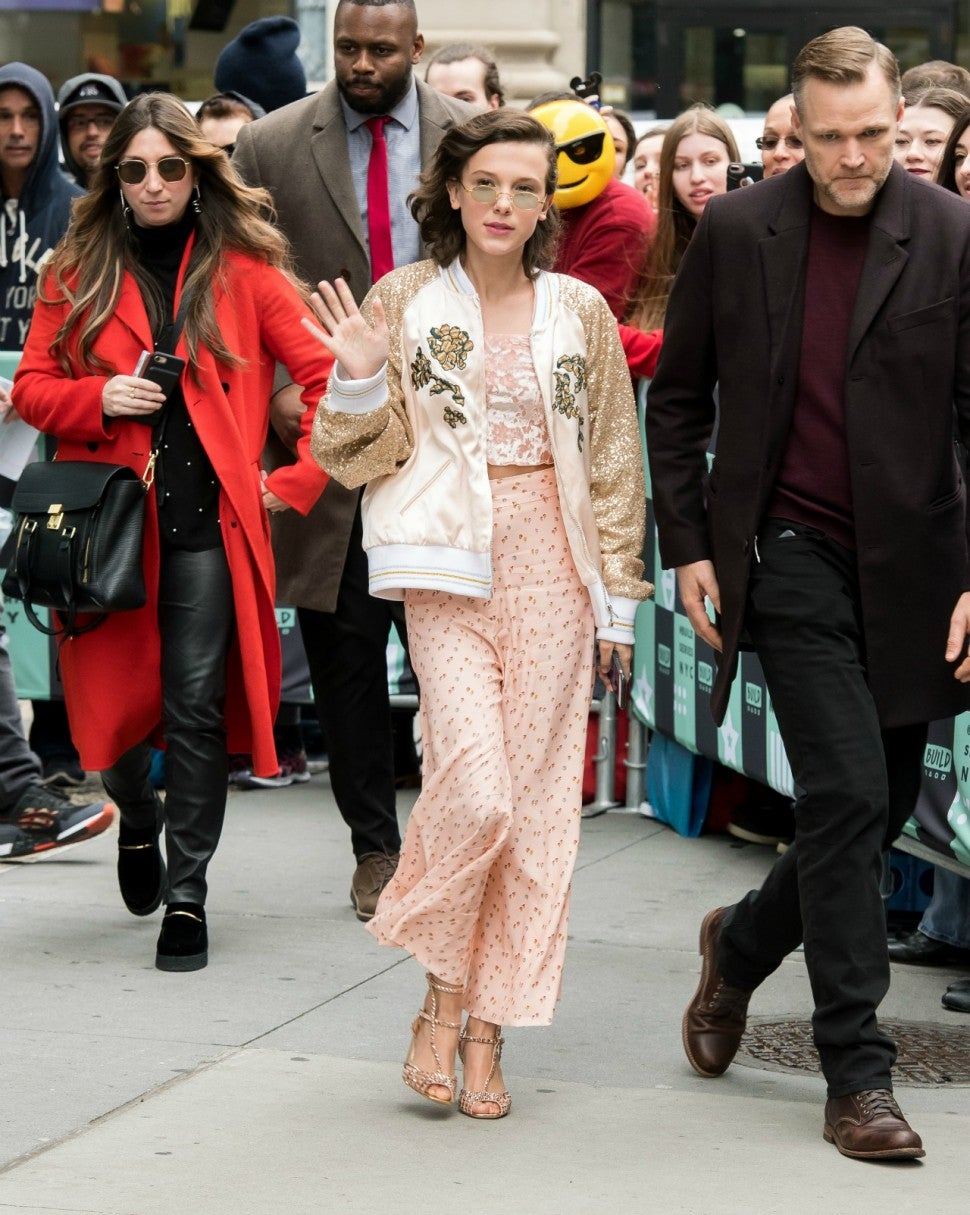 Millie Bobby Brown S Fashion Forward Press Day Mila Kunis Bold Boots More Best Dressed Stars Of The Week Entertainment Tonight