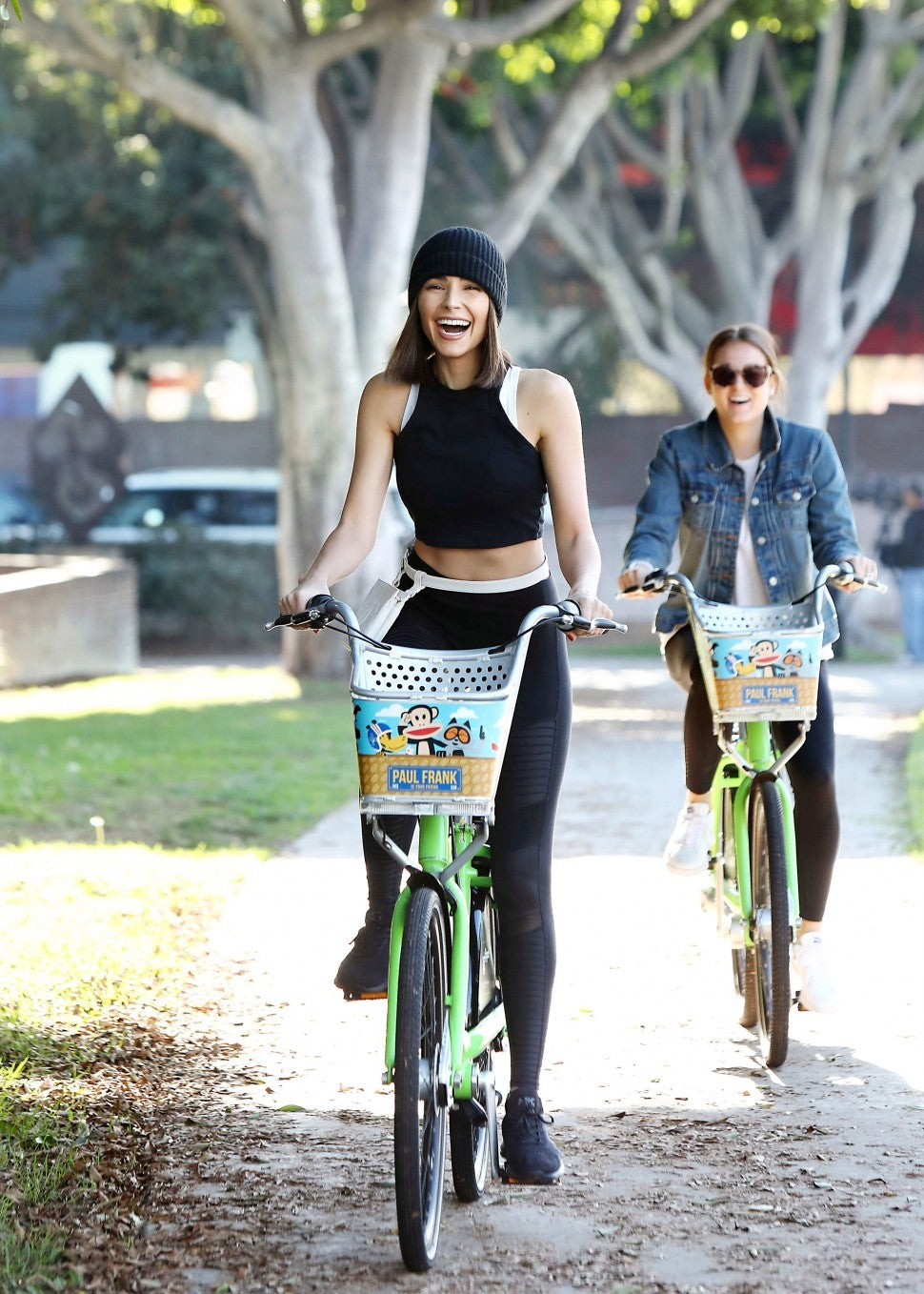 Olivia Culpo on bike in Weho