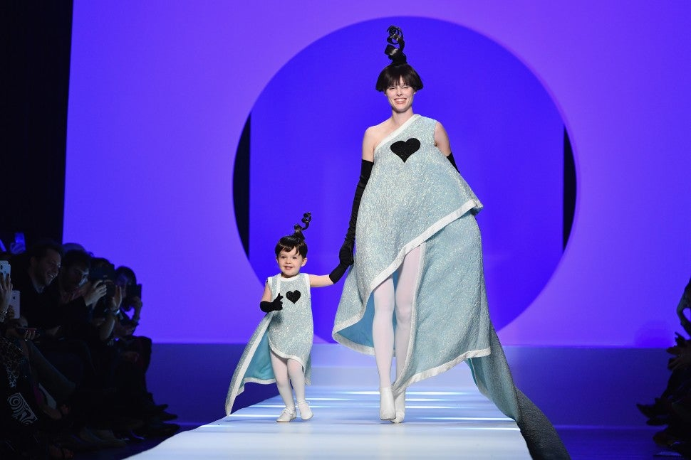 Coco Rocha and daughter Ioni at Paris Fashion Week