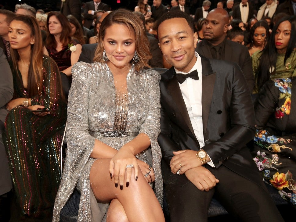 Chrissy Teigen and John Legend inside 2018 GRAMMYs