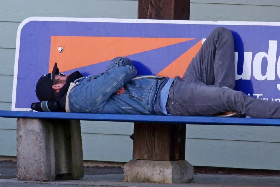 Chris Hemsworth takes a nap on a bench in Tofino, Canada, on Mar. 17.
