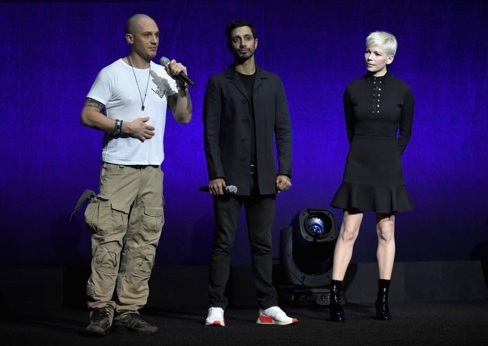 ctors Tom Hardy, Riz Ahmed and Michelle Williams speak onstage during the CinemaCon 2018