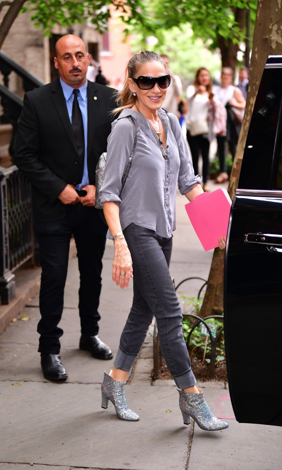 Sarah Jessica Parker in gray jeans