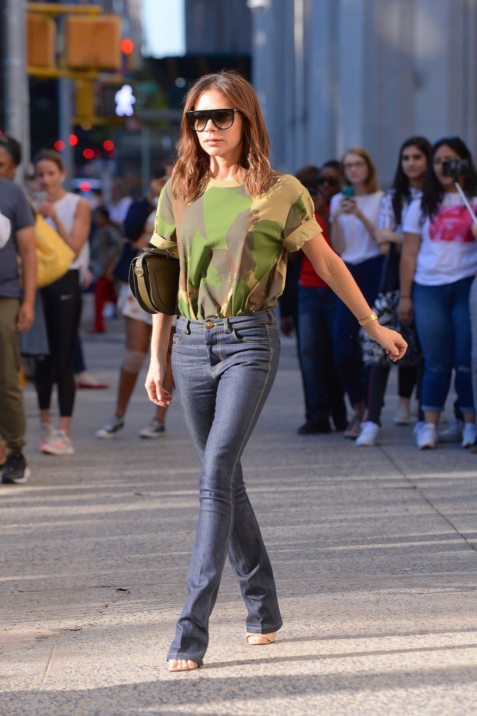 Victoria Beckham in camo tee and flared jeans