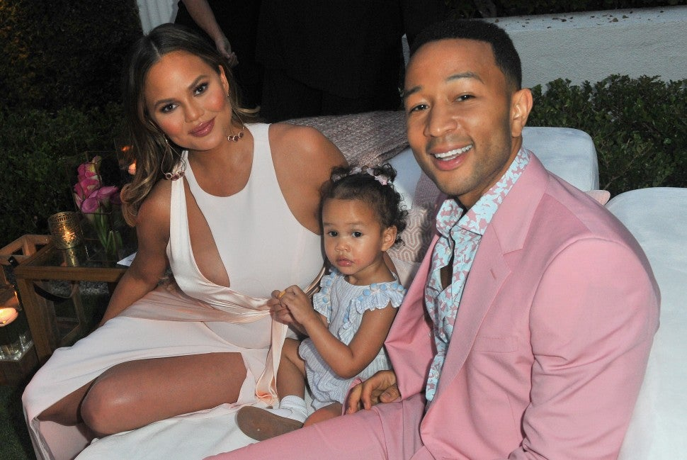 Chrissy Teigen, John Legend and Baby Luna in pink