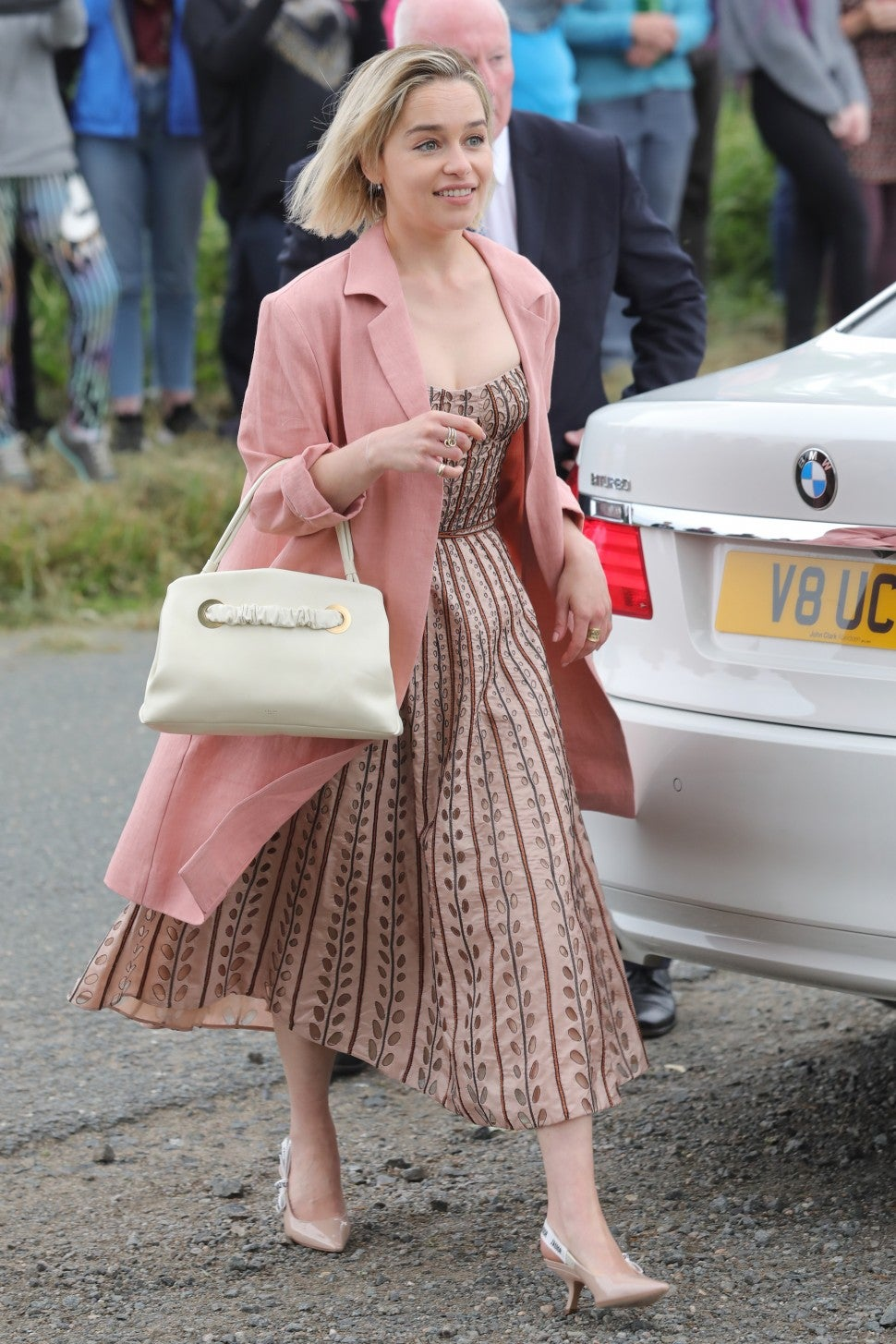 Emilia Clarke pink wedding guest dress
